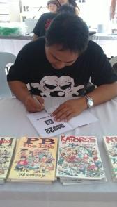 Pol Medina signing a book